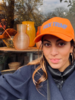 Los Enamorados Orange Baseball Cap with Fuck Trump in Sky Blue