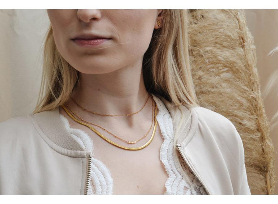 Triple eye gold necklace