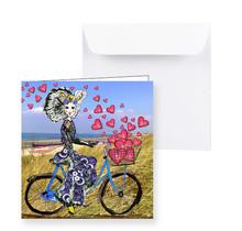 Zeeuwse kaart Zeeuws meisje op de fiets met hartjes  uit de fietsmand