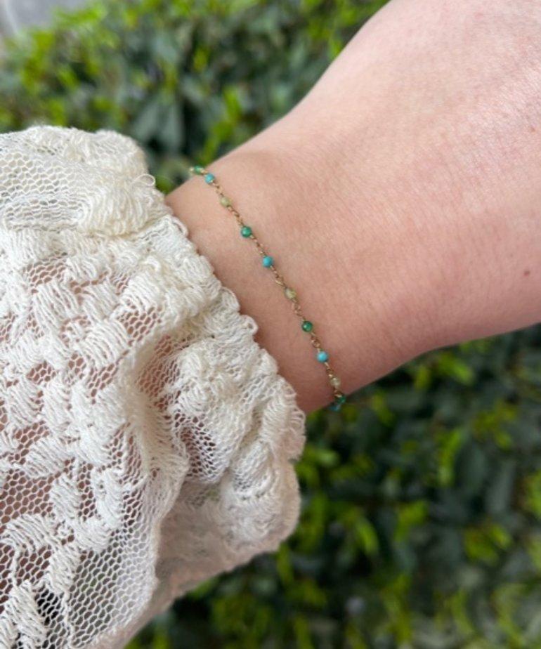 Zag Bijoux Zag Bijoux, Armband Goud Aqua Blauwe Steentjes