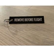 Sleutelhanger Remove before flight zwart