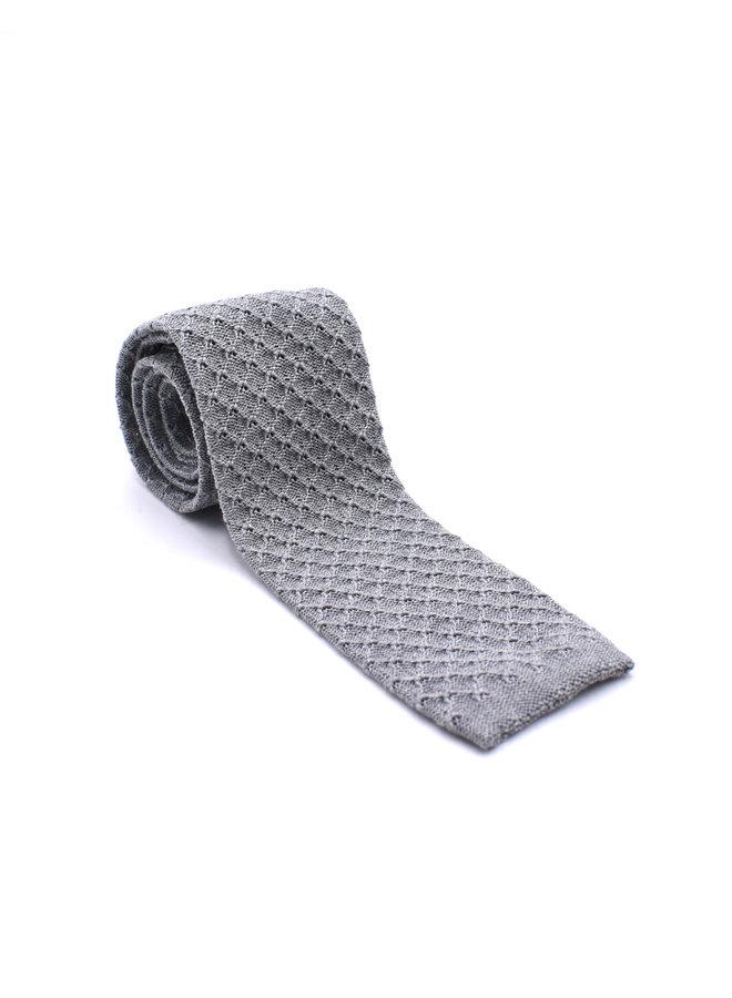 Cravate en tricot grise (texture)