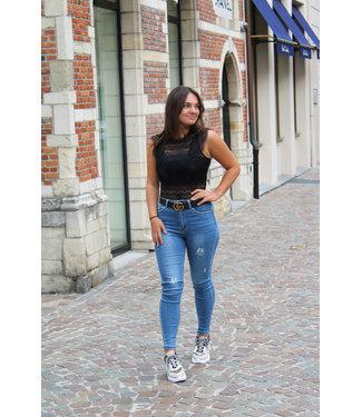 High waist jeans met scheuren