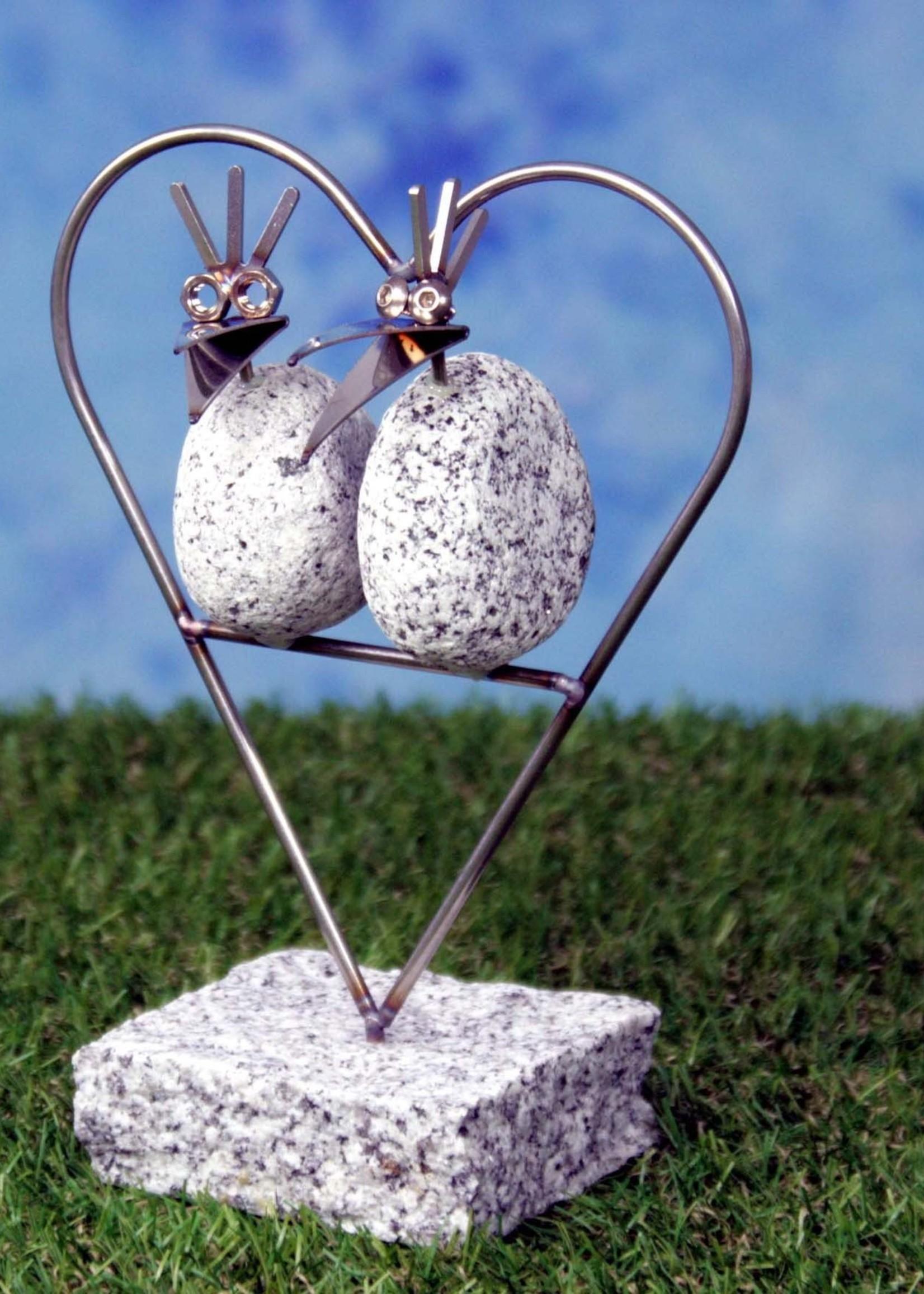 Lomprich Romantisch duo in hartje op steen