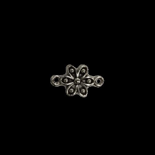 Zilveren tussenstuk in de vorm van een bloemetje