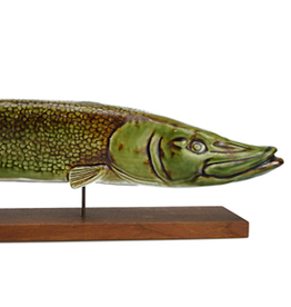 CERAMIC SCULPTURE OF SWIMMING PIKE ON TEAK BASE