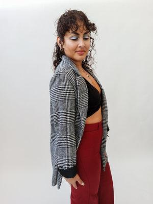 Zwart wit geruite jas