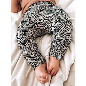4 baby en kids Legging zebra zand
