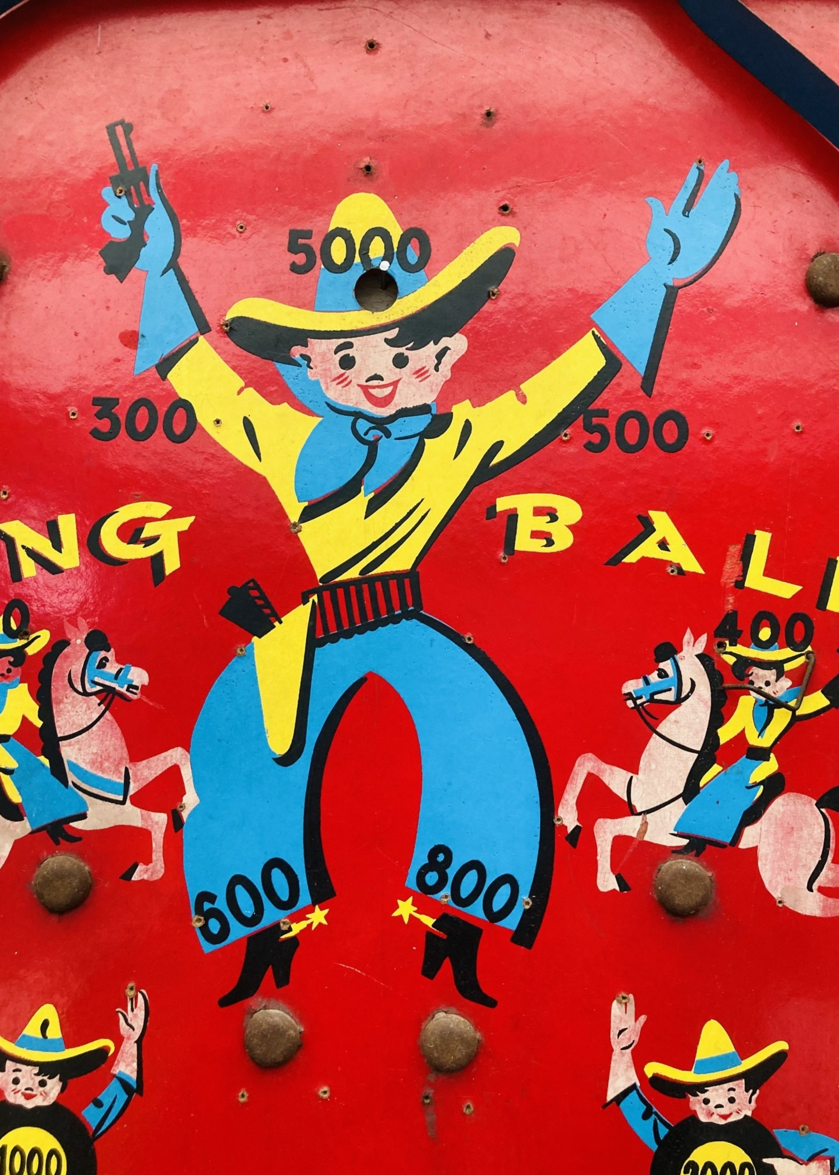 Decorative wooden and metal games Red and blue with cowboy children