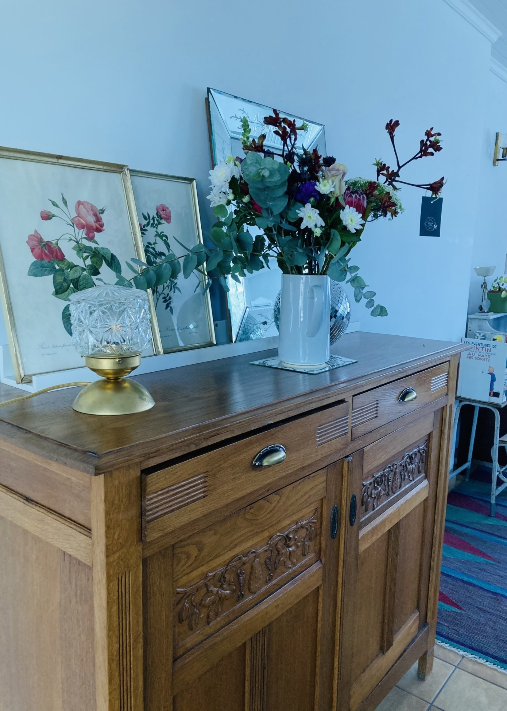Oak chest with drawers and fruit carved on doors