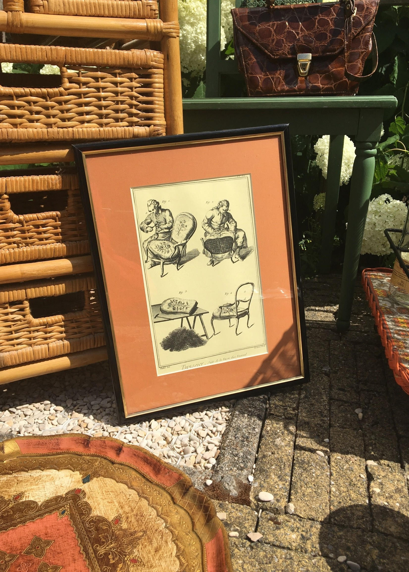 Furniture worker engraving in frame with peach coloured contour