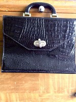 Black lacquered crocodile bag without shoulder strap with gold closure