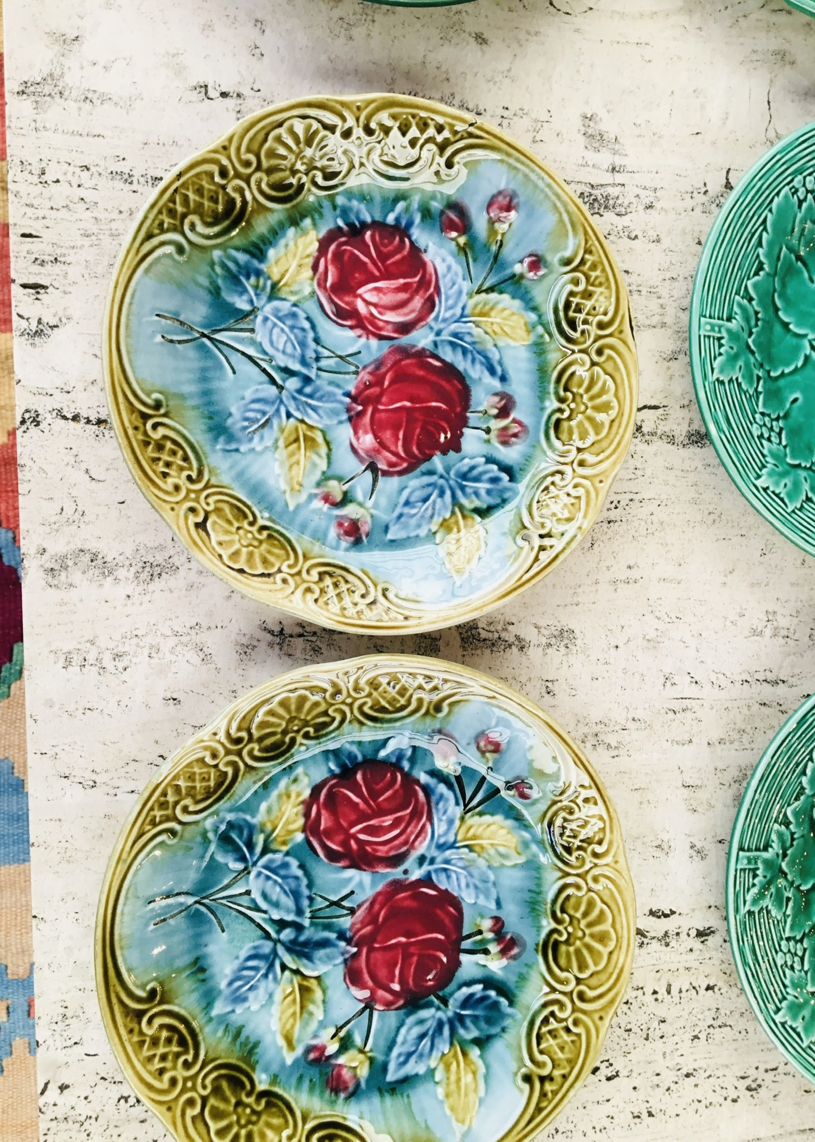 2 plates in blue barbotine with pink and green flower decoration 20cm Diam.