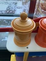 Plastic pot with orange
