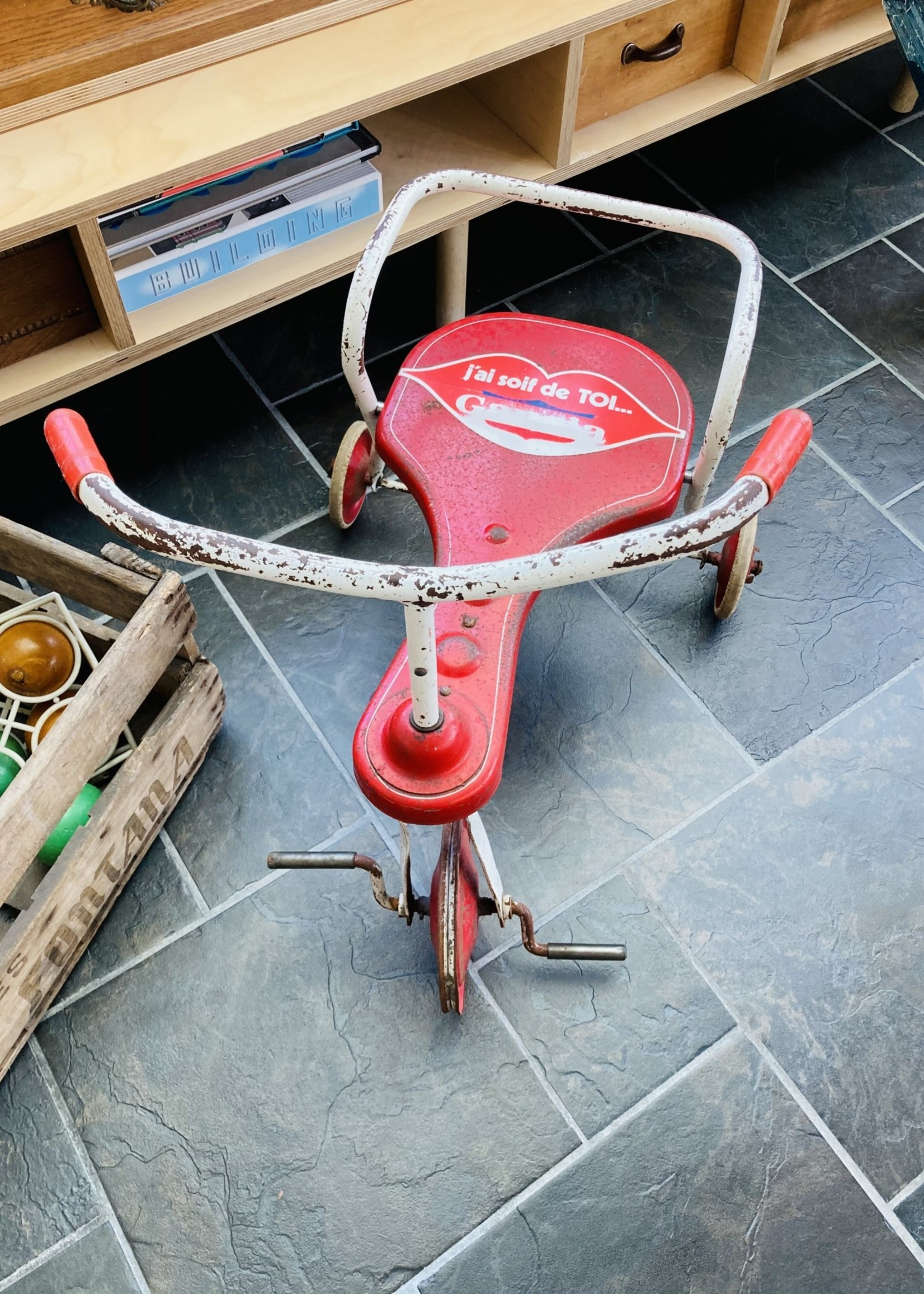 Vintage red and white tricycle