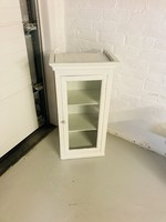 Showcase small white with pineapple button and window door