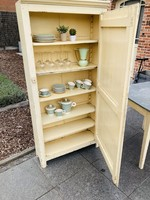 Cloister thin cabinet in light yellow