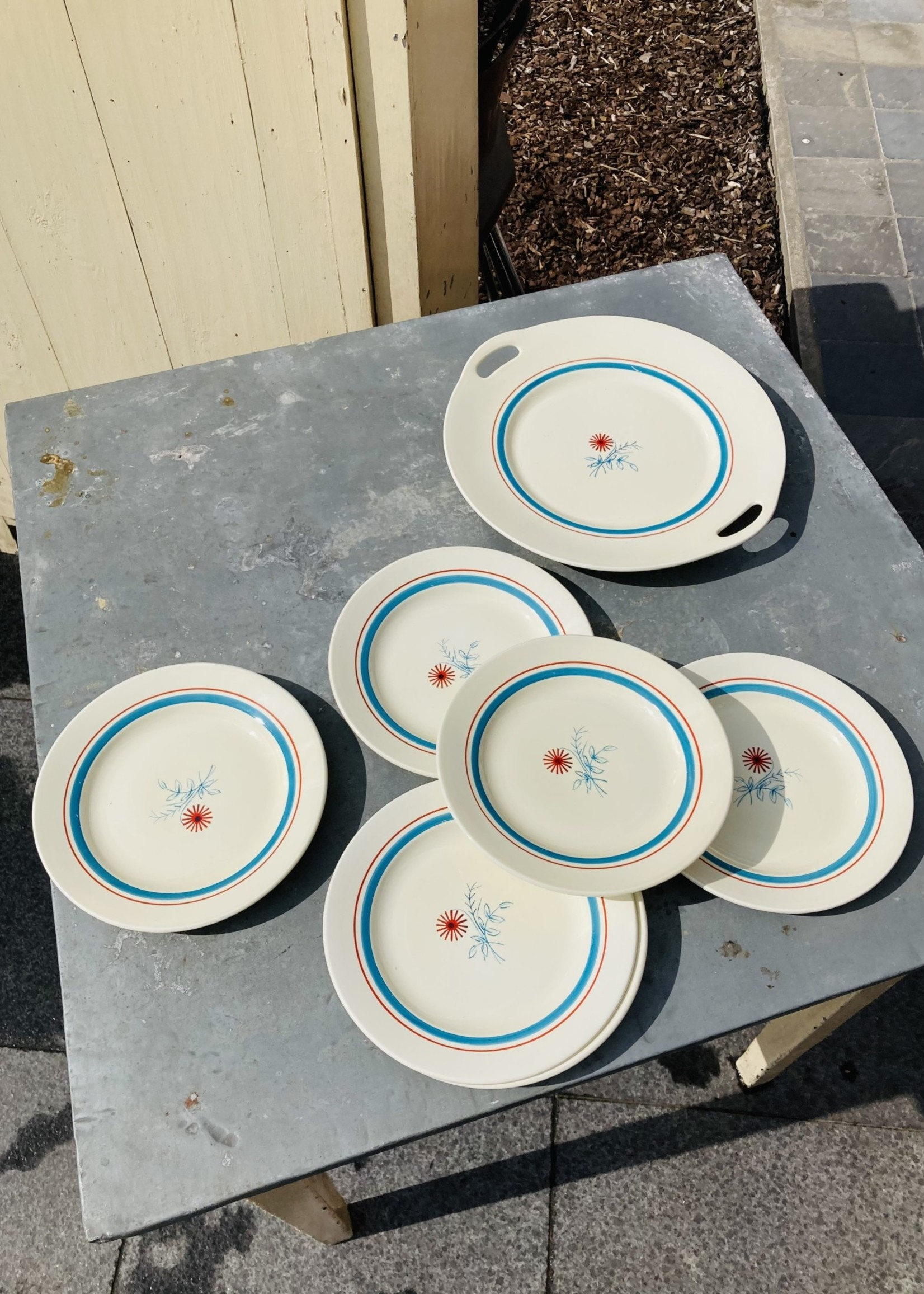 Desert Plates from Nimy with Blue and red flower
