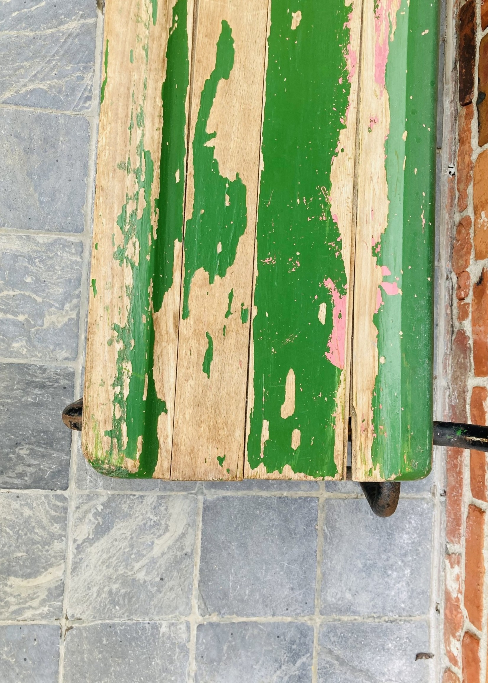 Antique green school bench with pink spots