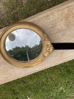 Small round bombed mirror with golden frame