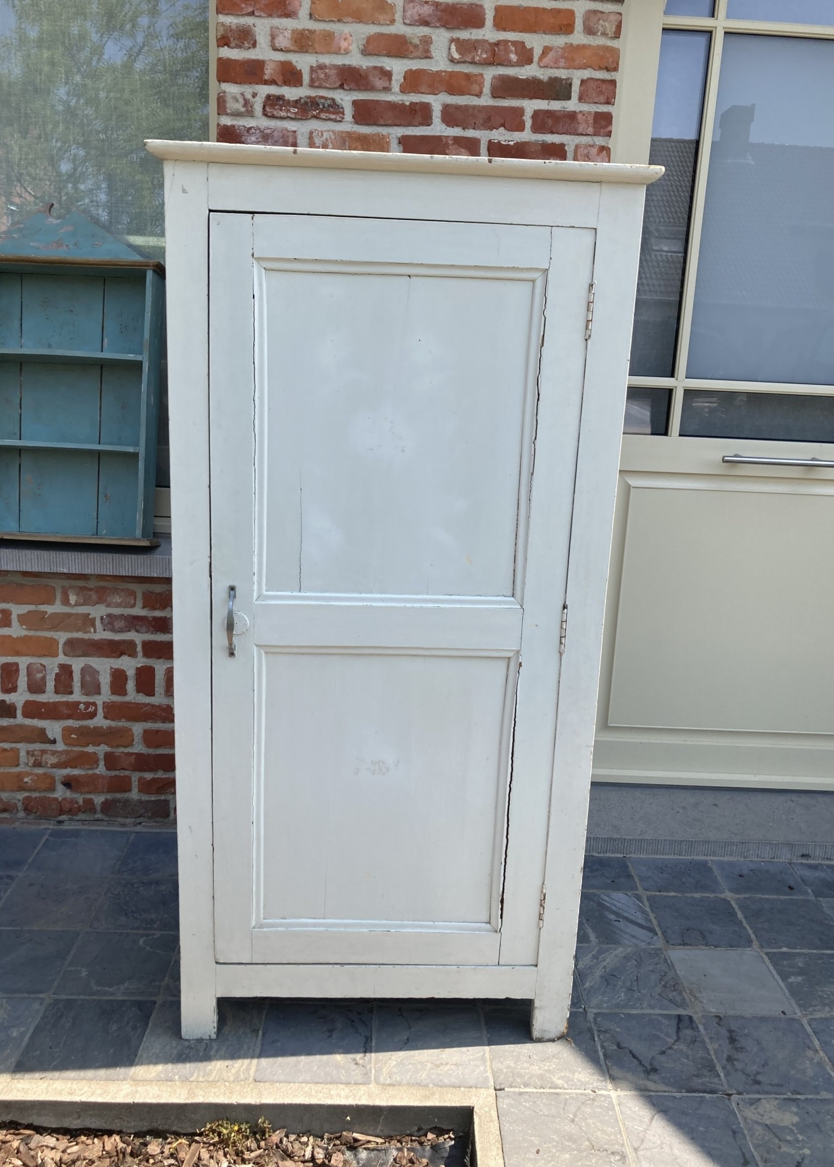 Small white cabinet with 3 shelves one door and white patina