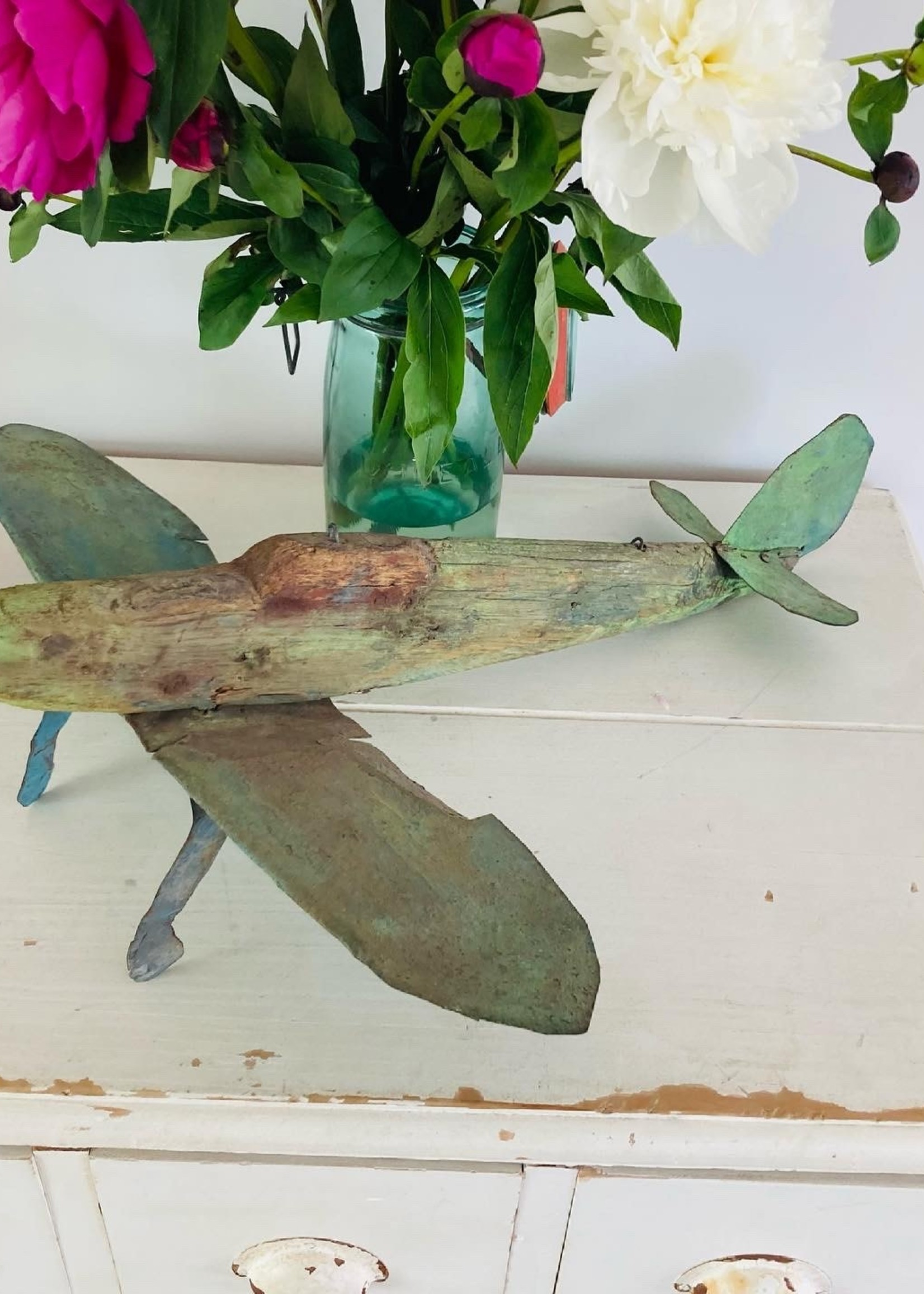 Antique and unique wooden spitfire with green patina 1920