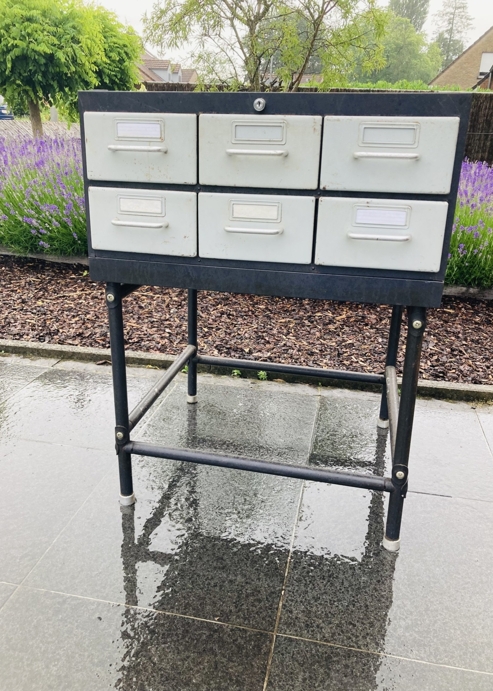 Old metal cabinet with small drawers on base (in 3 parts)
