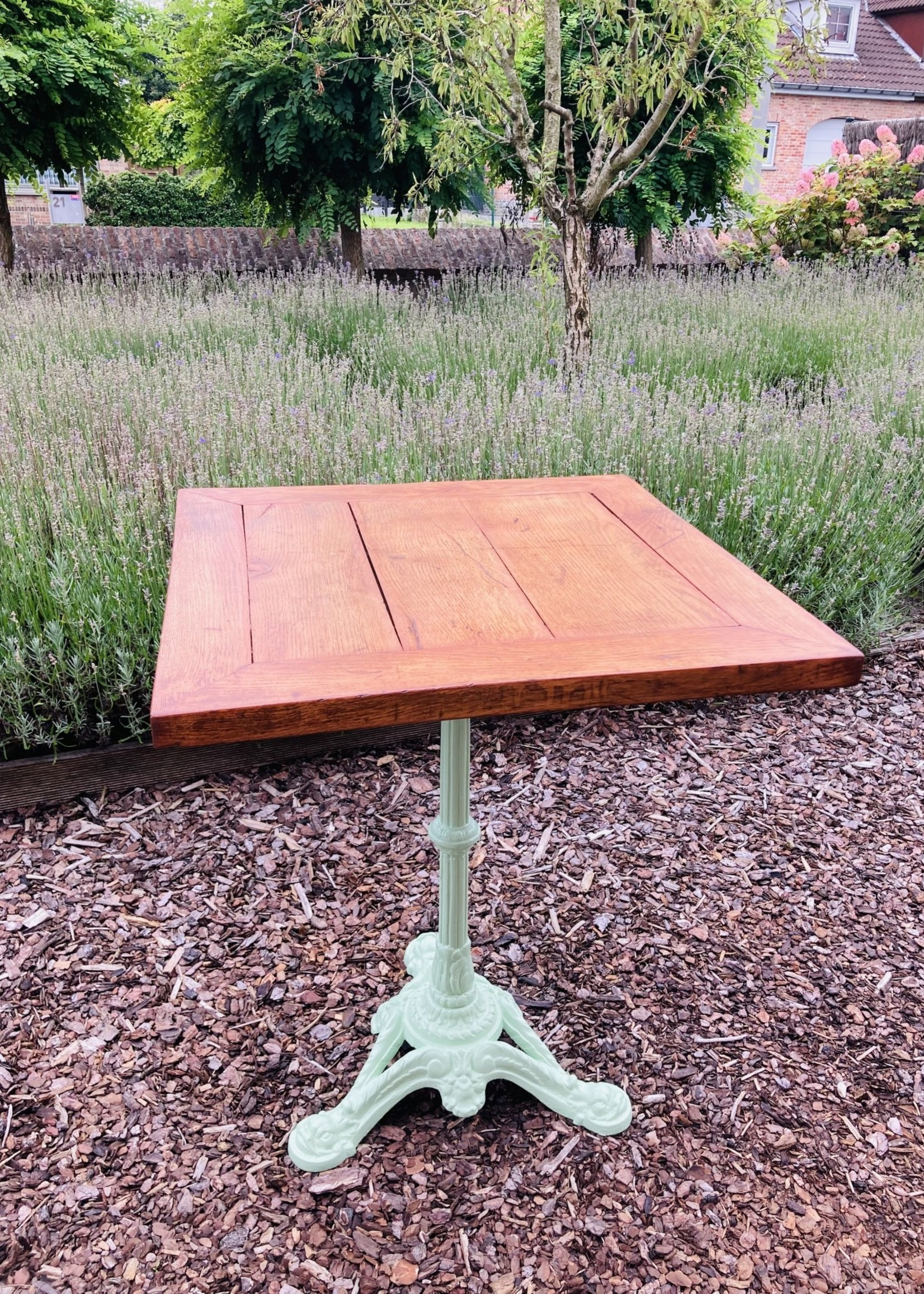 Antique square table with wooden table top and green painted cast iron base