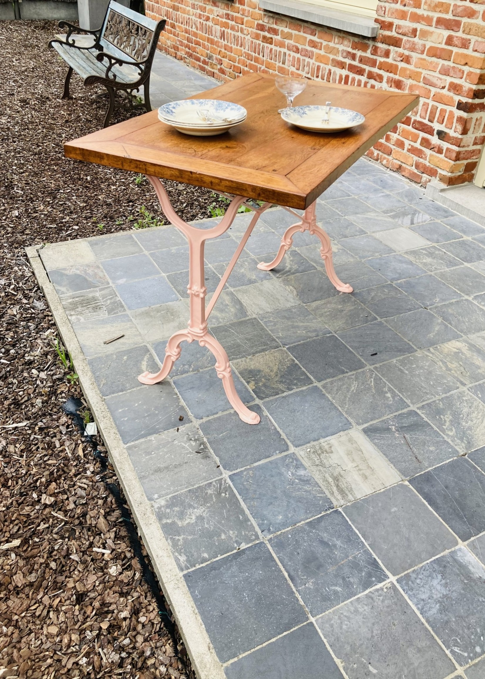 Rectangular table with wooden table top and pink painted cast iron base, bistrot style