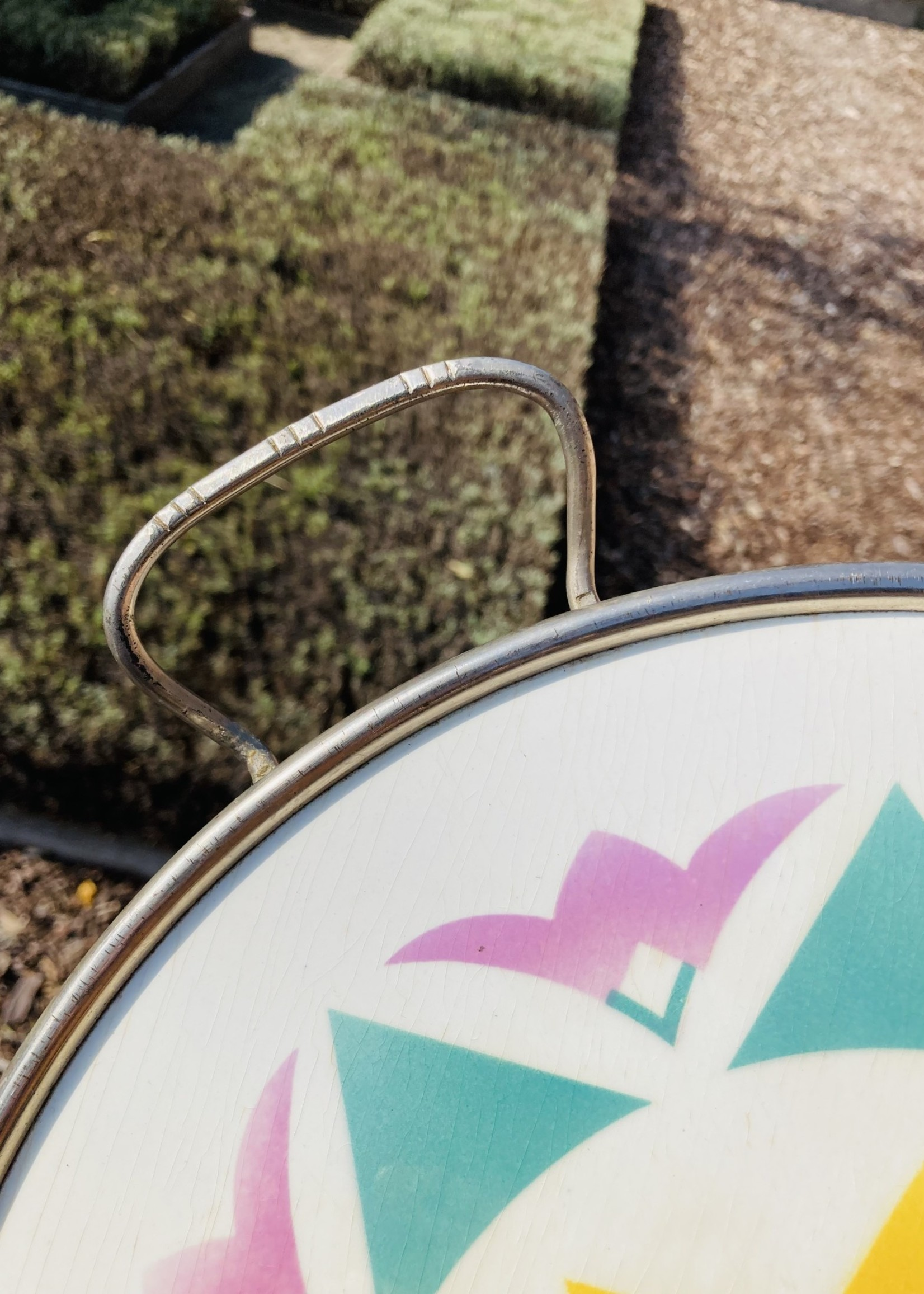 Antique French tray  in ceramique with pastel coloured pattern and metal ring with handles