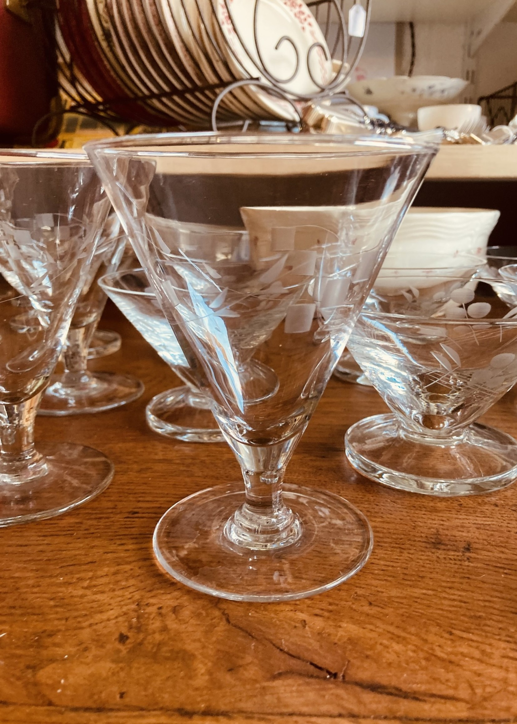 Large water glasses conic shaped with carved fruit in glass