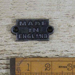 IRON RANGE Made in England Plaque Iron Finish 52mm x 28mm