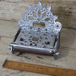 IRON RANGE Victorian Toilet Roll Holder Plated Chrome on Iron with Lid This Fixture has a duller Sheen than our Chrome on Brass.