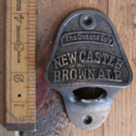 IRON RANGE Bottle Opener Wall Fixing NEWCASTLE BROWN ALE Cast Antique Iron
