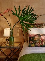 Esther's Flamingo Room's pillows, green plush