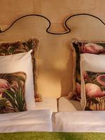 Esther's Flamingo Room's pillows, gold plush
