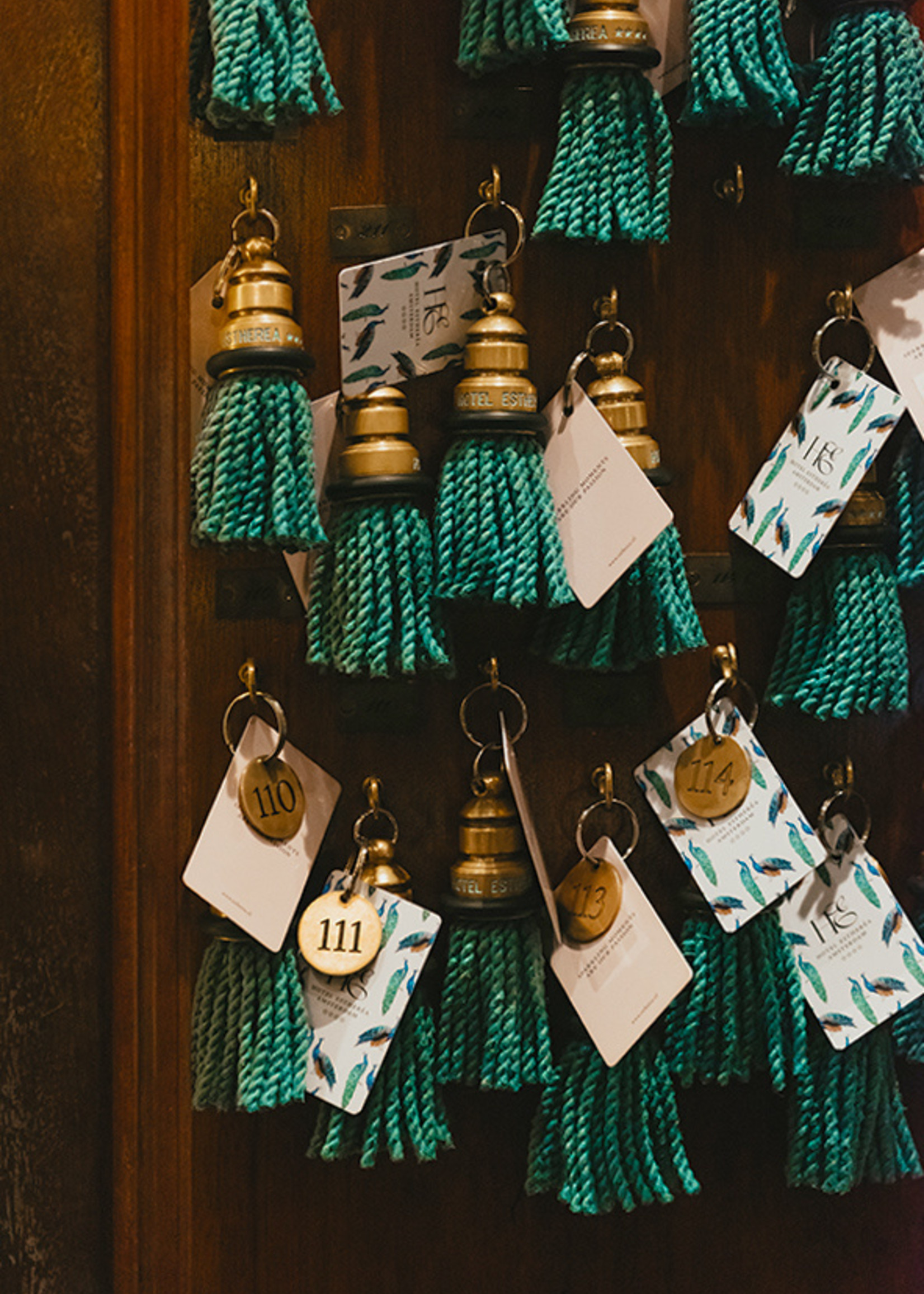 Esther's Hotel Estheréa custom keychain with blue fringe