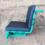 Groene stoel met zwarte kussens