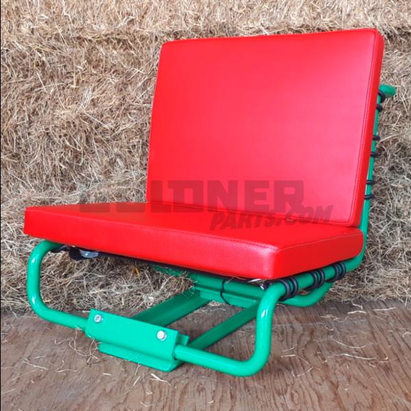Grüner Sitz mit rotem Kissen