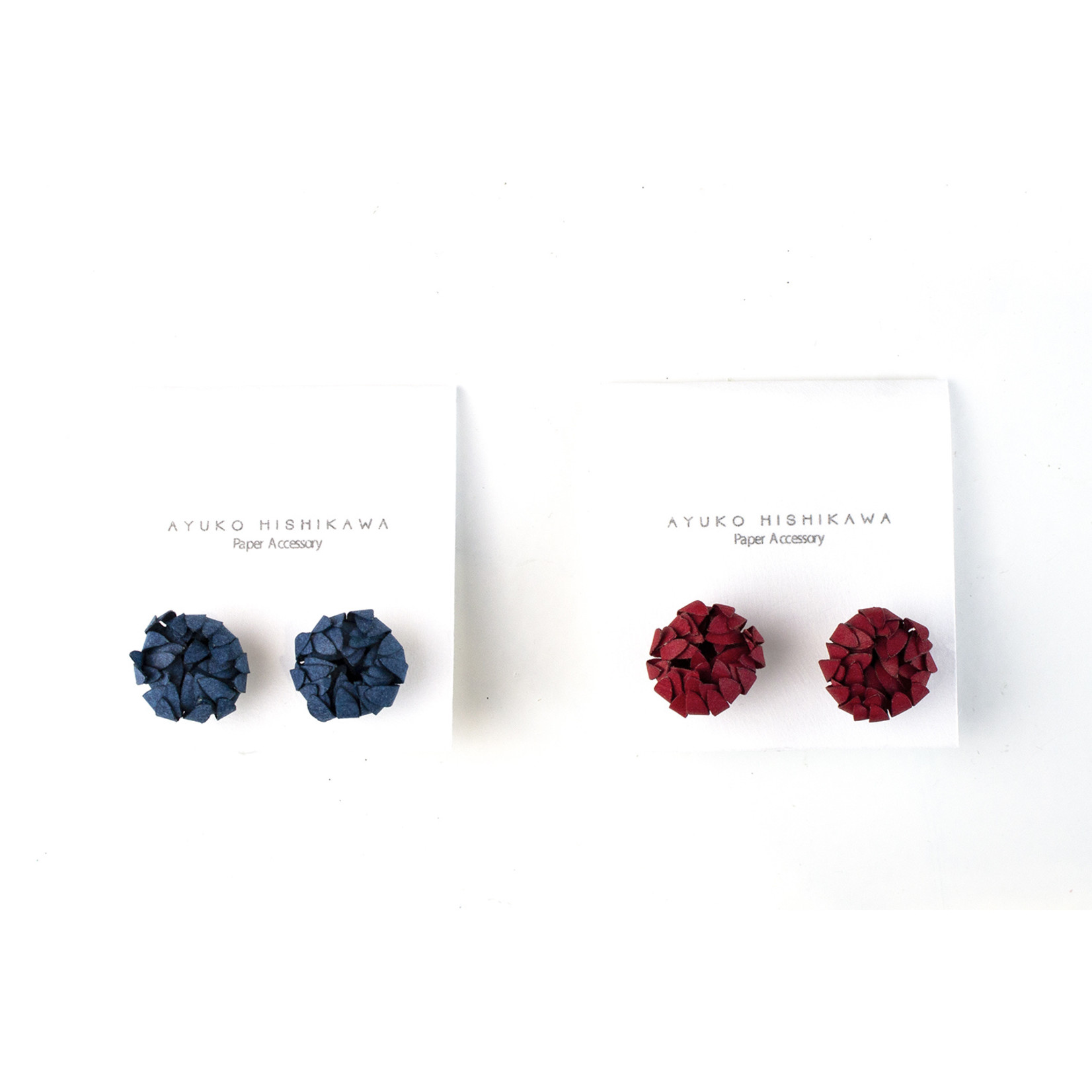 Based on Roots PAPER ACCESSORY pair stud earrings