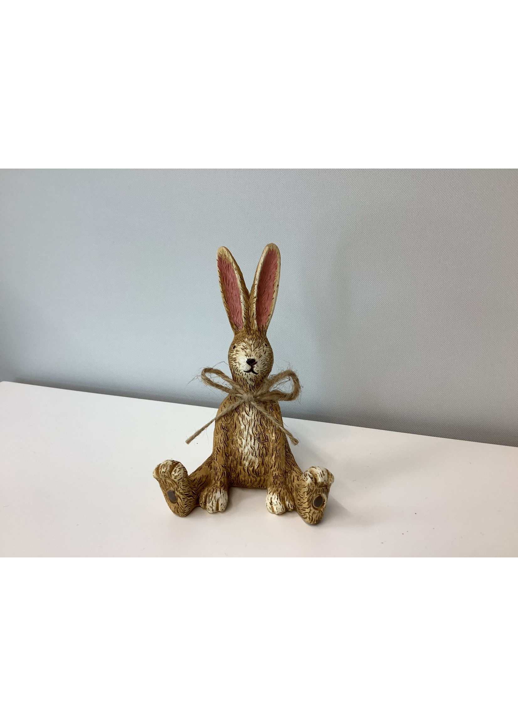 Sitting rabbit with hessian bow