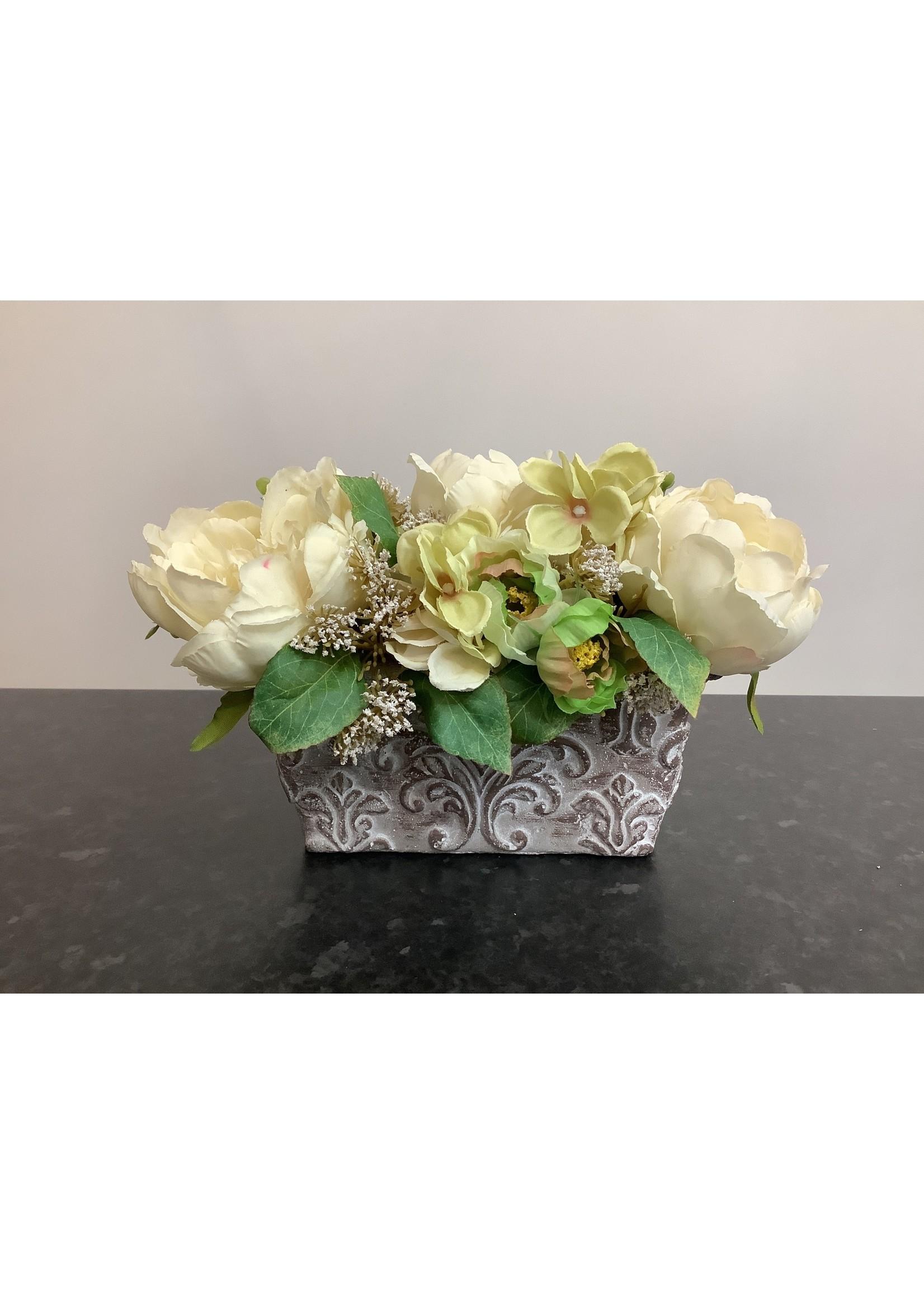 Small vintage flowers in oblong vase 18x18cm