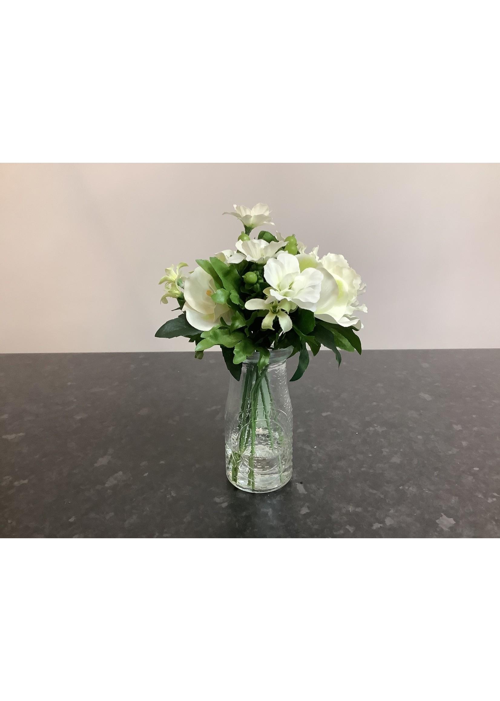 Small flower arrangement in vintage milk bottle  20cm tall