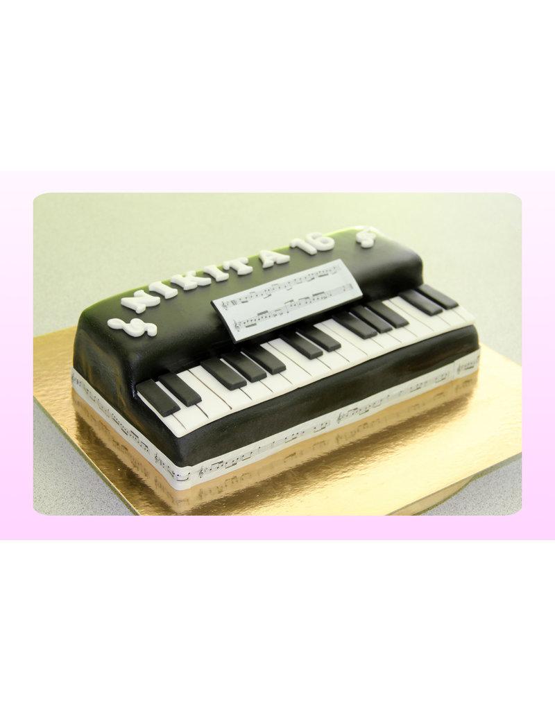 1. Sweet Planet Piano taart