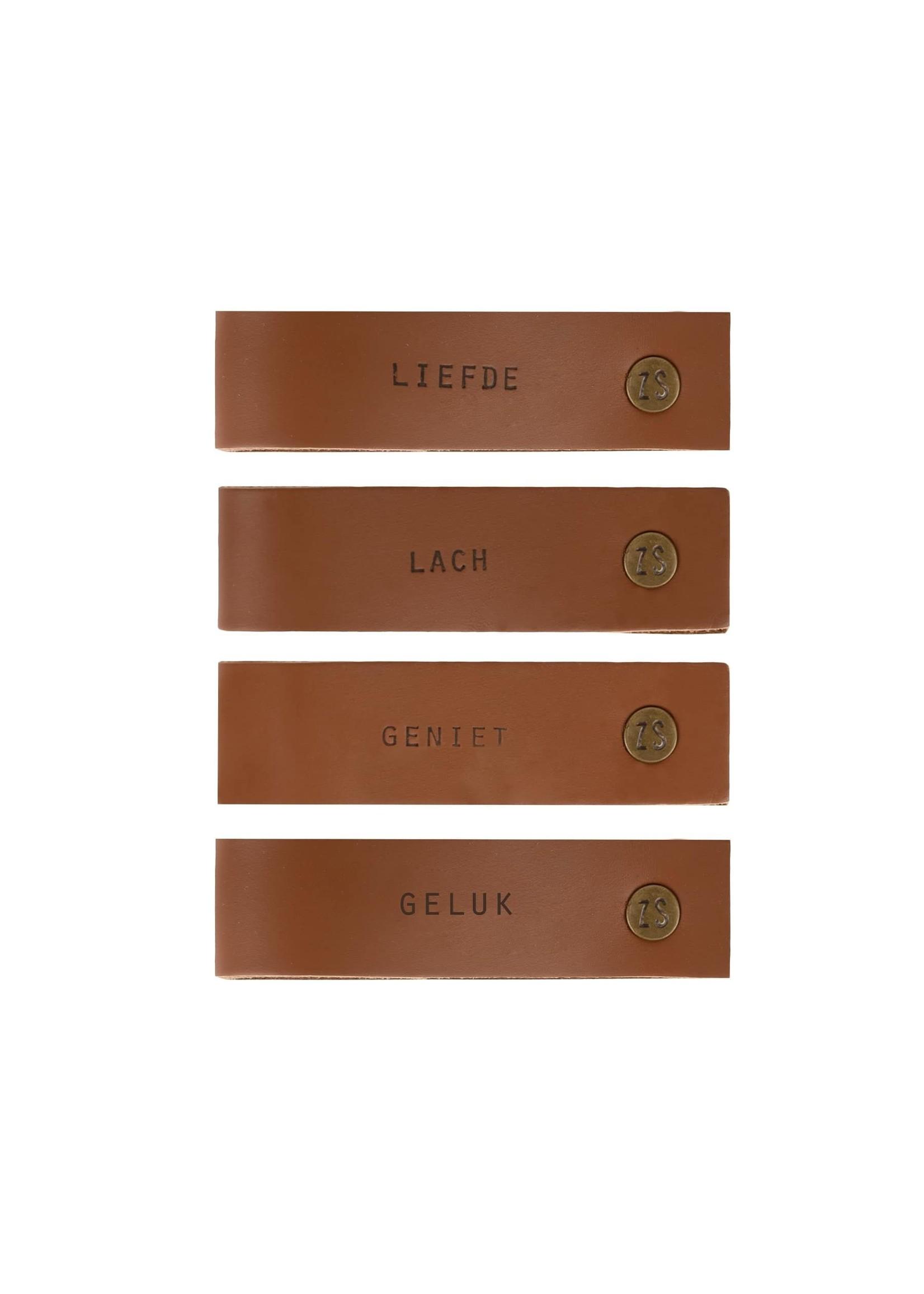 ZUSSS set van 4 leren servetringen met tekst bruin