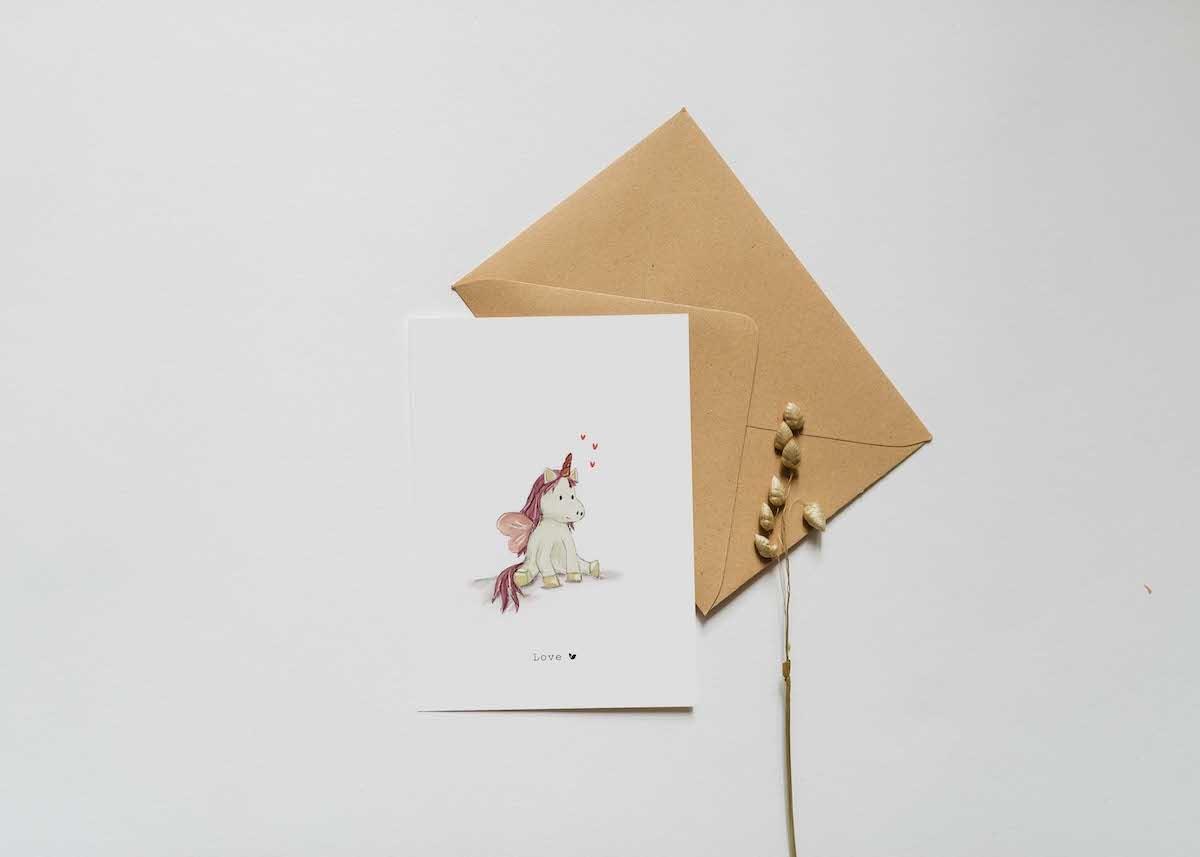 Nadine's illustraties wenskaart  unicorn roze-2