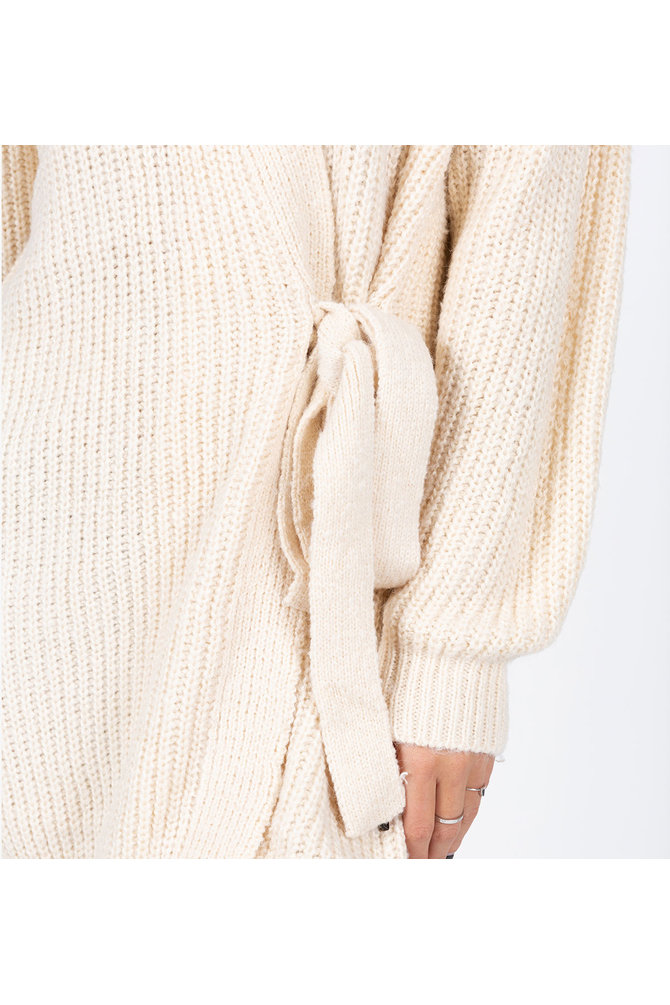 Crème lange wikkel trui