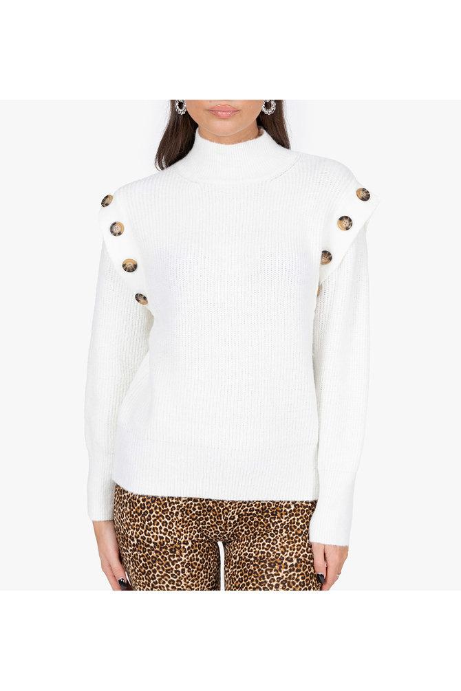 Witte trui met knopen