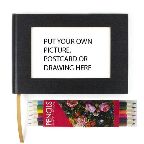 Crayons de couleur et carnet de croquis