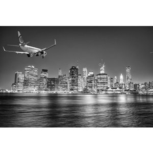 Airplane landing New York at night